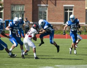 Football takes on Battling Bishops under the lights
