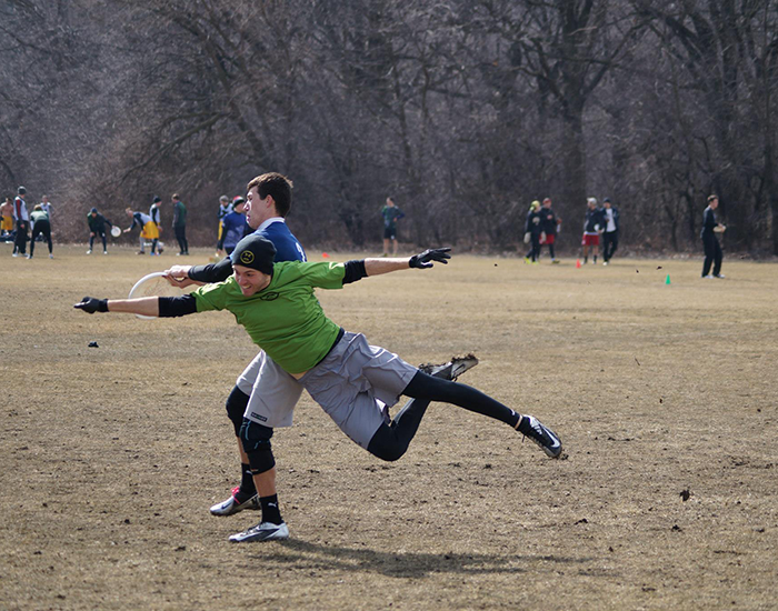 Junior Matt McGoogan makes a grab over a diving defender from Carnegie Mellon in the Fighting Gobies 13-9 loss in pool play.  Case would rebound to reel of five straight wins before losing in the championship match to Oregon State, 12-10.