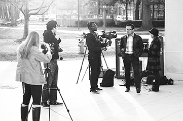 Donald Qiao, founder and president of independent student group Case TV, interviews unsuspecting students.