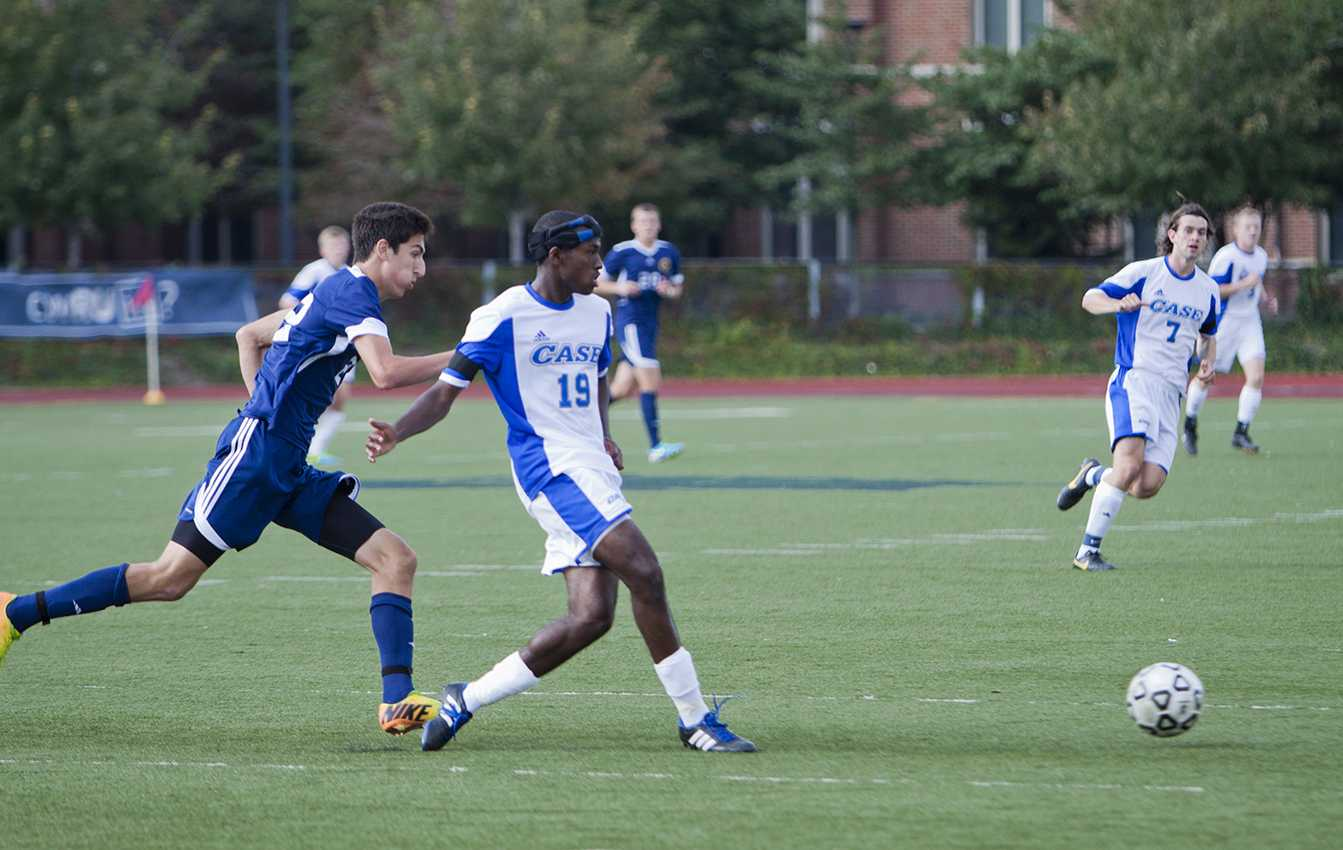 CWRU players Taylor Fletcher and Slater Jameson race to the ball versus Franklin University in last weekend's match.
