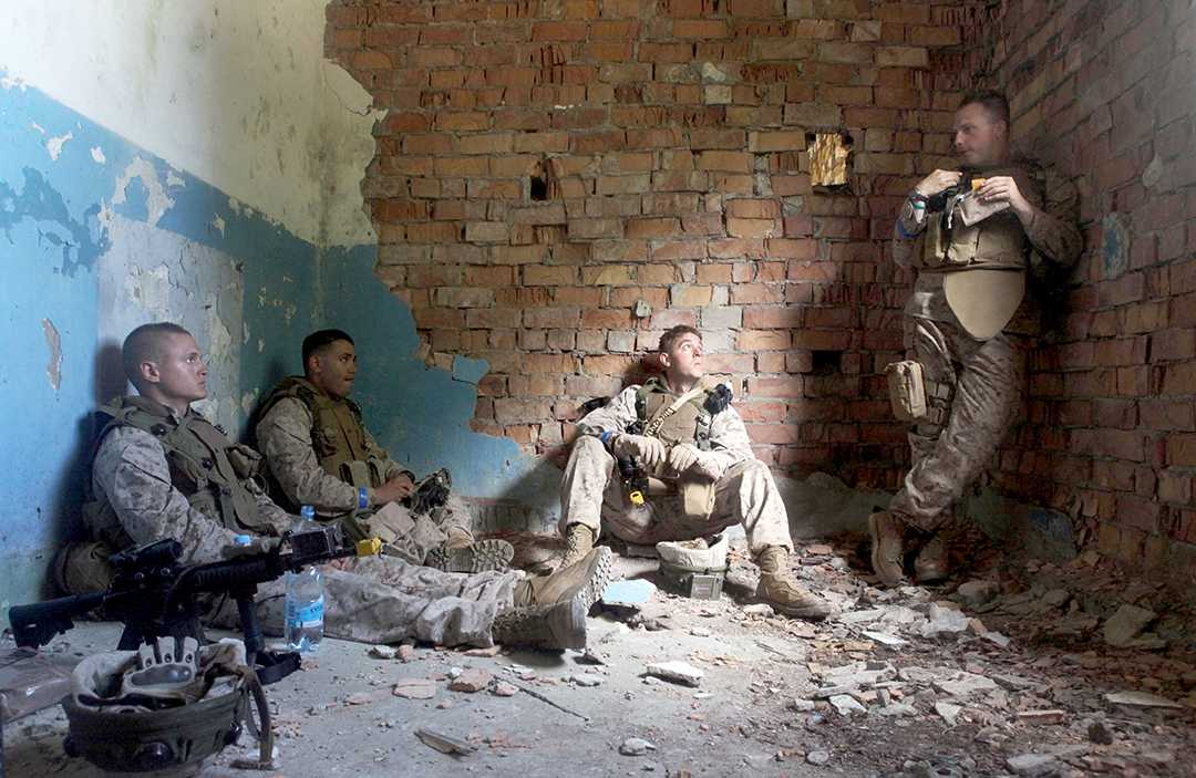 CWRU student Steven Maire, pictured far right, takes a lunch break with team members while stationed in Afghanistan.