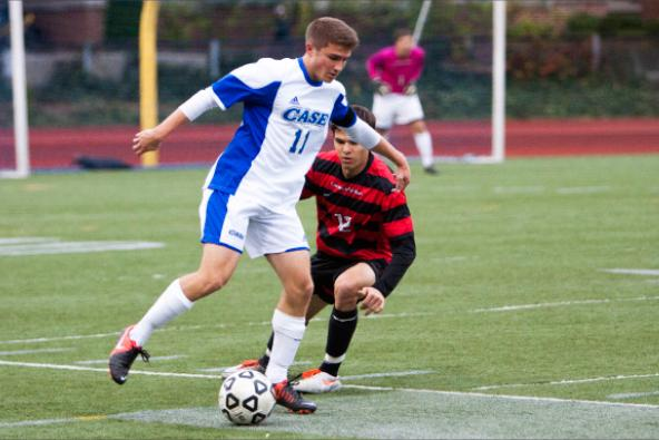 Freshman Zach Broujos battles past the opposition during loss versus Carnegie Mellon on Nov. 1.