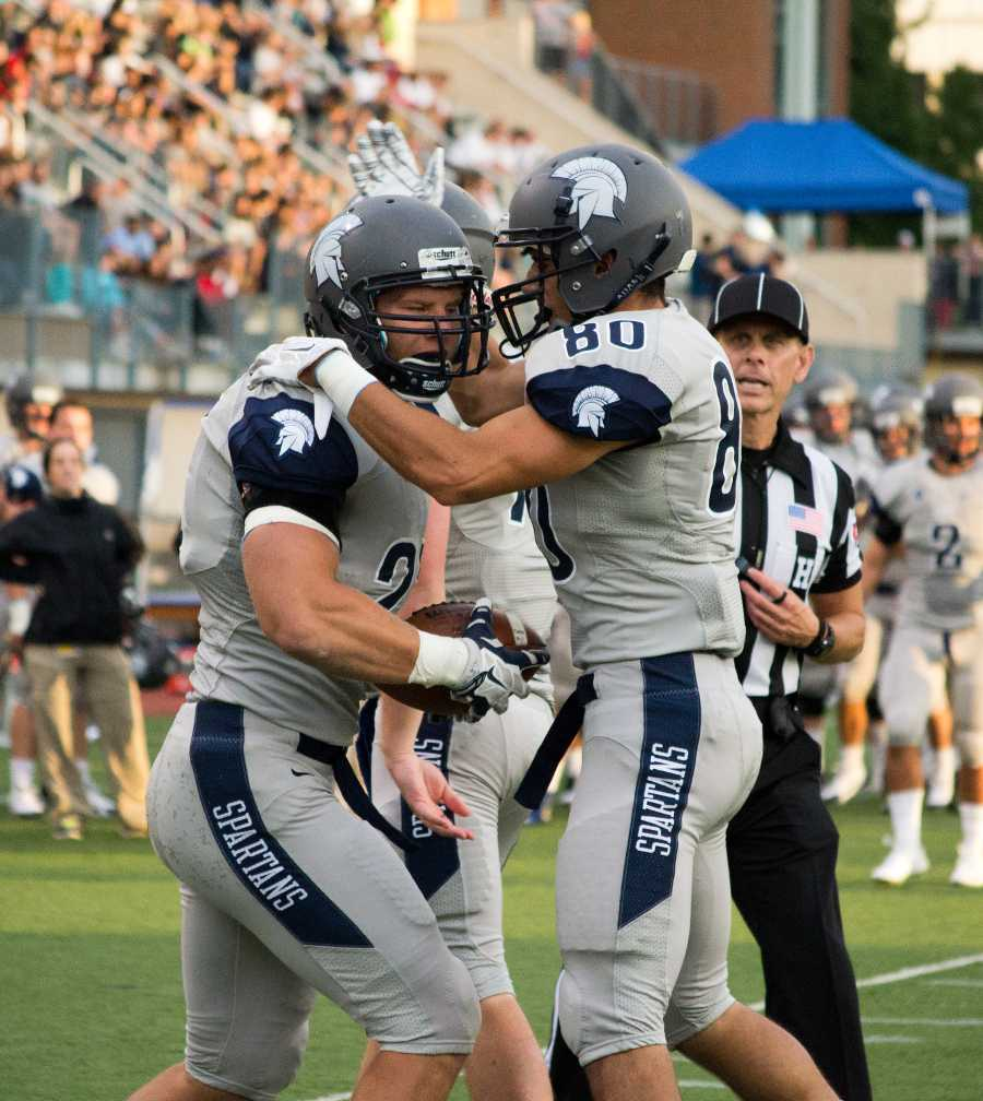 Wide recievers Luke DiFrancesco (right) and Ethan Albers celebrate their opening game victory against Carnegie Mellon University. Andrew Hodowanec/Observer
