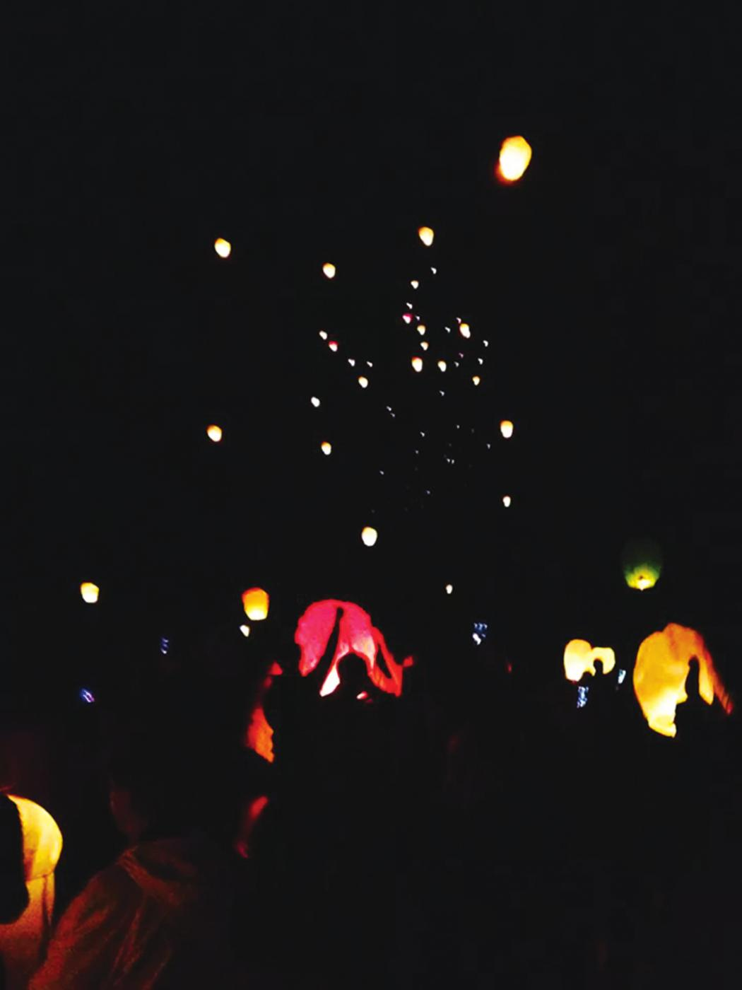 Friends of the late sophomore William Michael Felten release paper lanterns at a service in his honor at his hometown of Saginaw, Michigan.