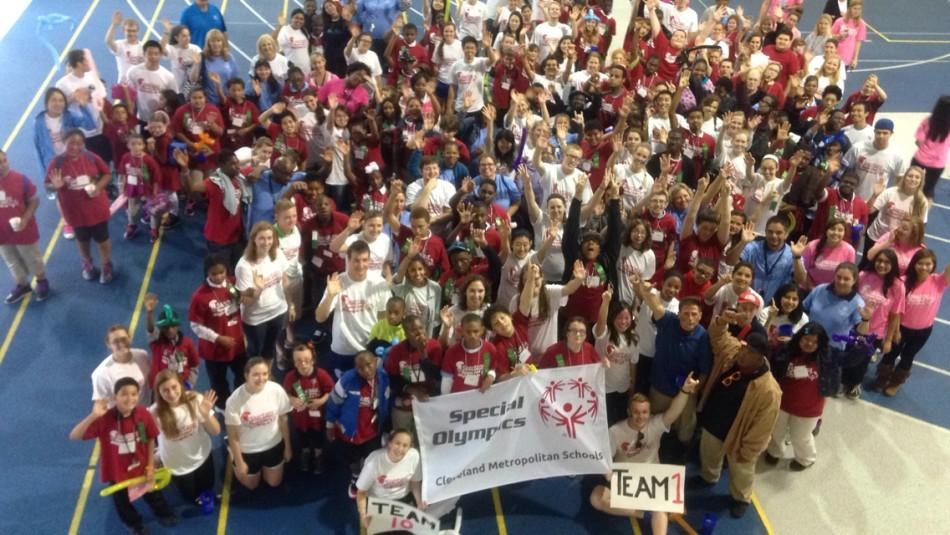 Special+Olympics+organizers+and+volunteers+gather+for+a+group+picture+after+a+successful+event.