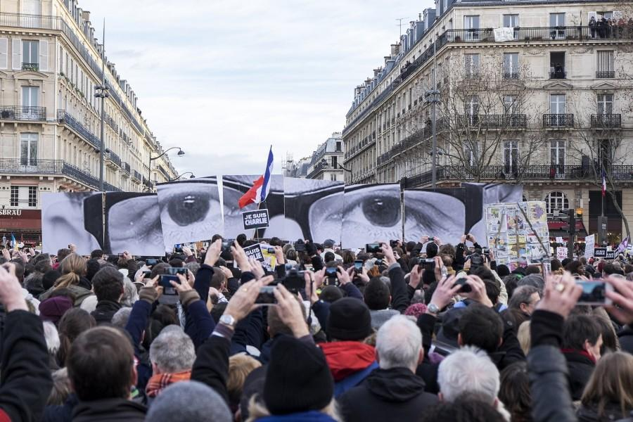 The+attack+on+the+Charlie+Hebdo+offices+elicited+strong+reactions+worldwide.