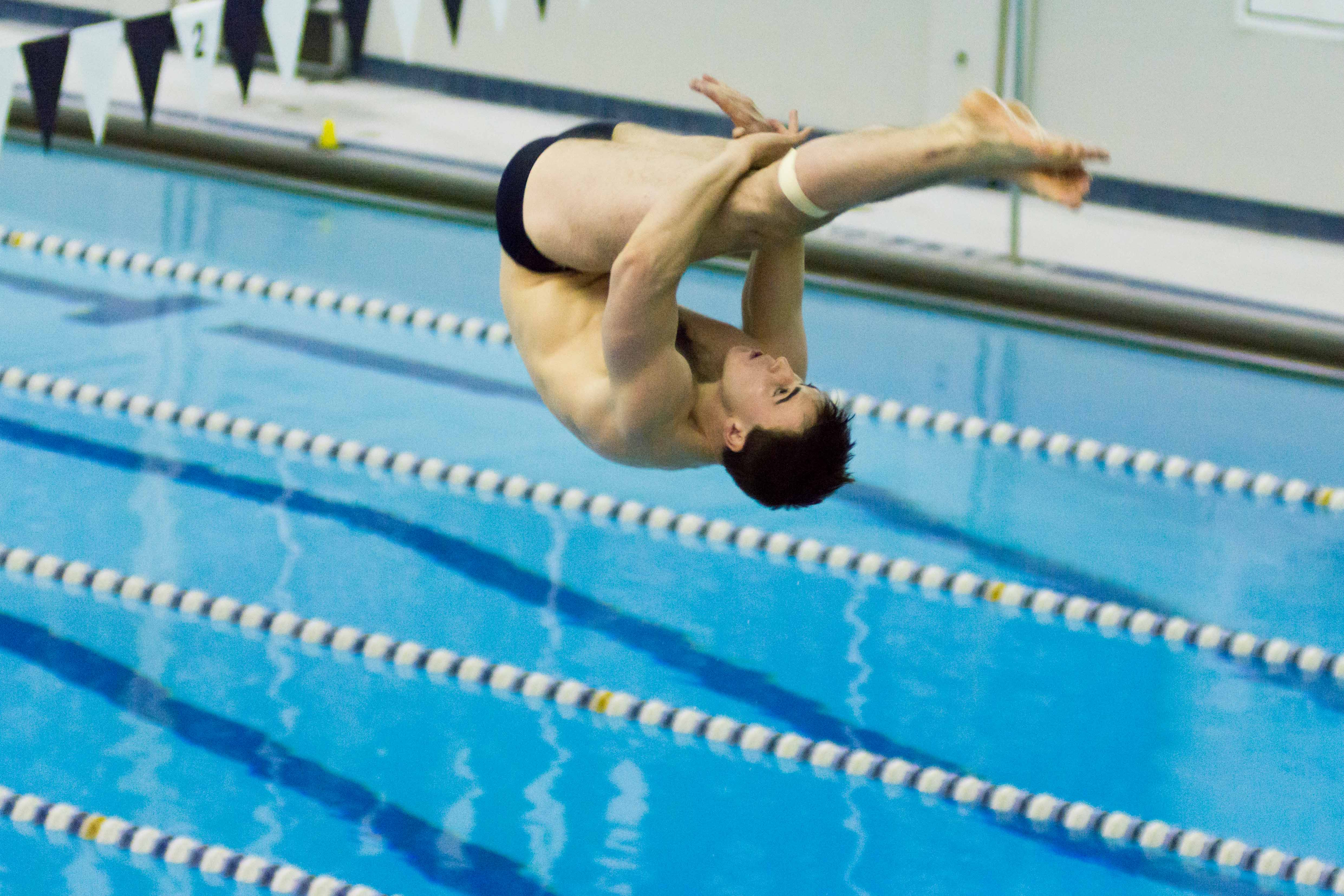 Men's diver Connor Farrell mid-dive. Farrell had two first place dives for the Spartans.