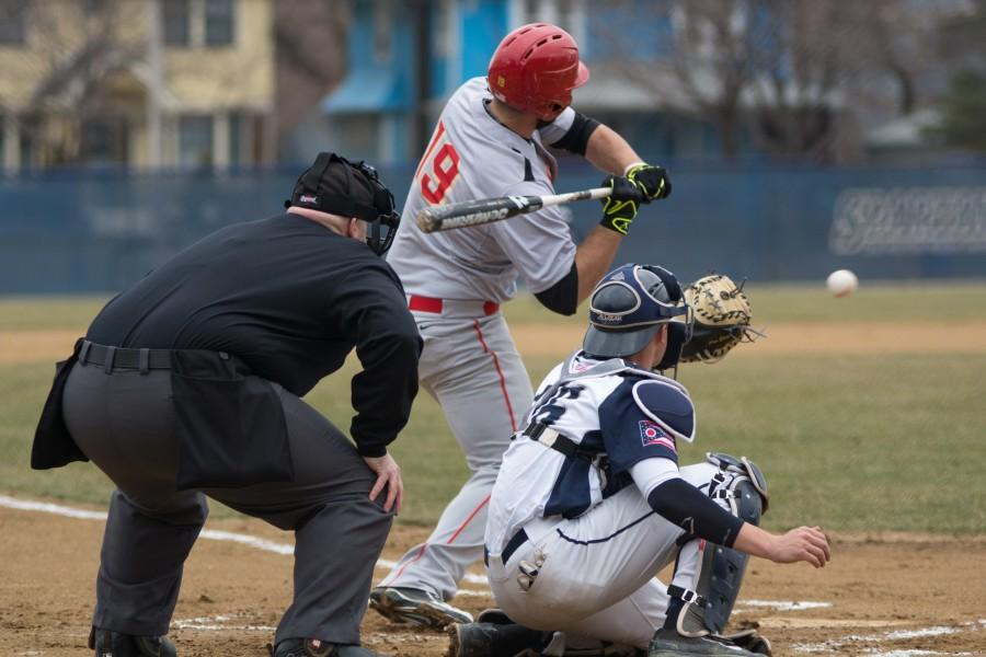 Sophomore+Catcher+Eric+Eldred+receives+the+pitch+for+a+strike+against+the+Otterbein+batter.+Eldred+and+the+Spartans+picked+up+their+first+win+at+home+this+season+against+Otterbein+on+Wednesday+afternoon.