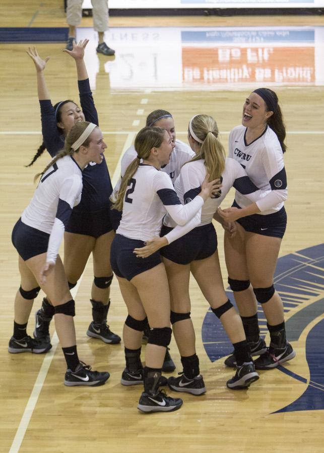 The Volleyball team celebrates last season after a kill. The Spartans had a lot to celebrate as they swept their four games this weekend so start the season 5-0.