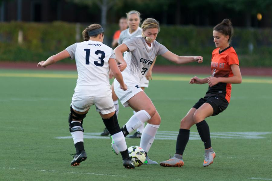The Spartans battle for the ball earlier this season against Buffalo St., the Spartans slipped against UAA rivals this weekend.