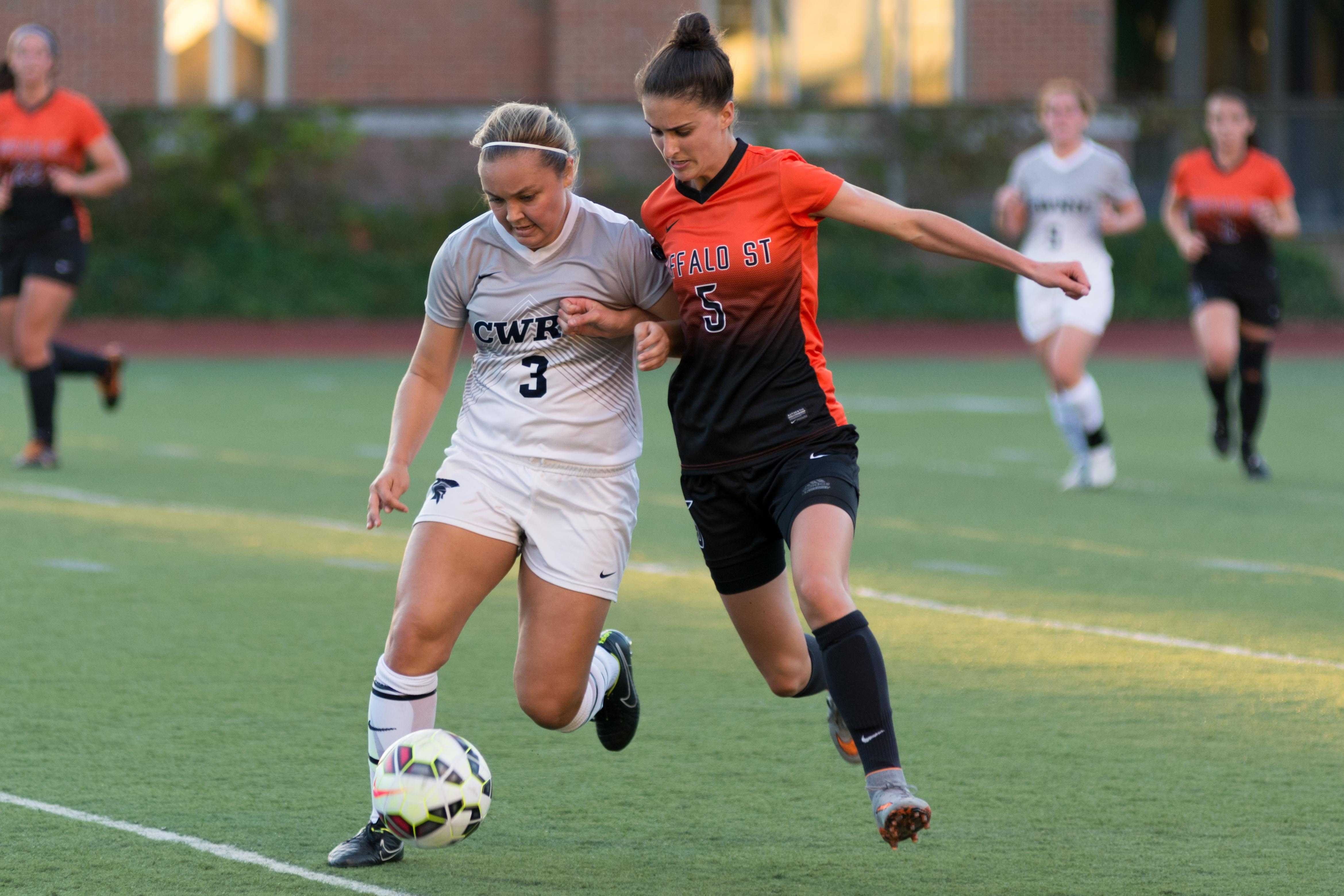 Third year student Amy Lindberg battles for possession against Buffalo St earlier this season.