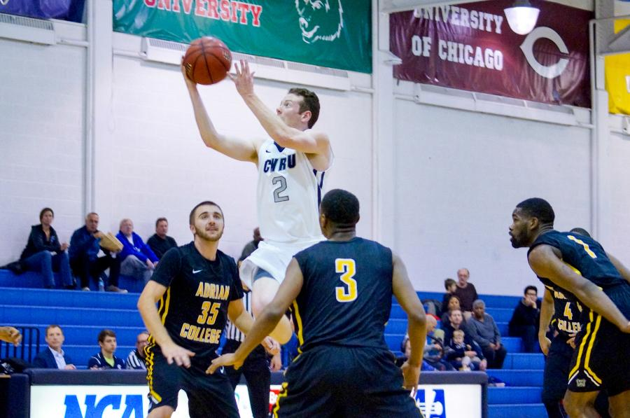 Spartan point guard Jimmy Holman drives the lane for the bucket earlier this season. Holman and the Spartans sit atop the UAA heading into this weekend.