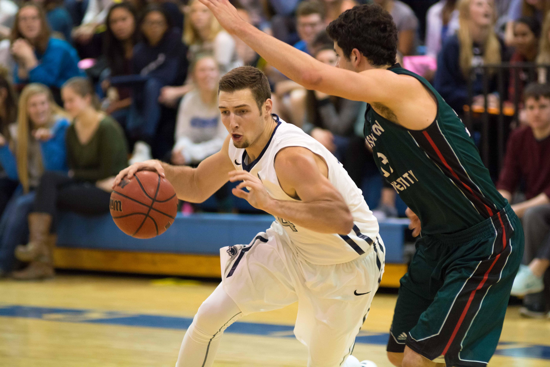 Jake Lavis drives past a Washington University at St. Louis defender this past weekend.