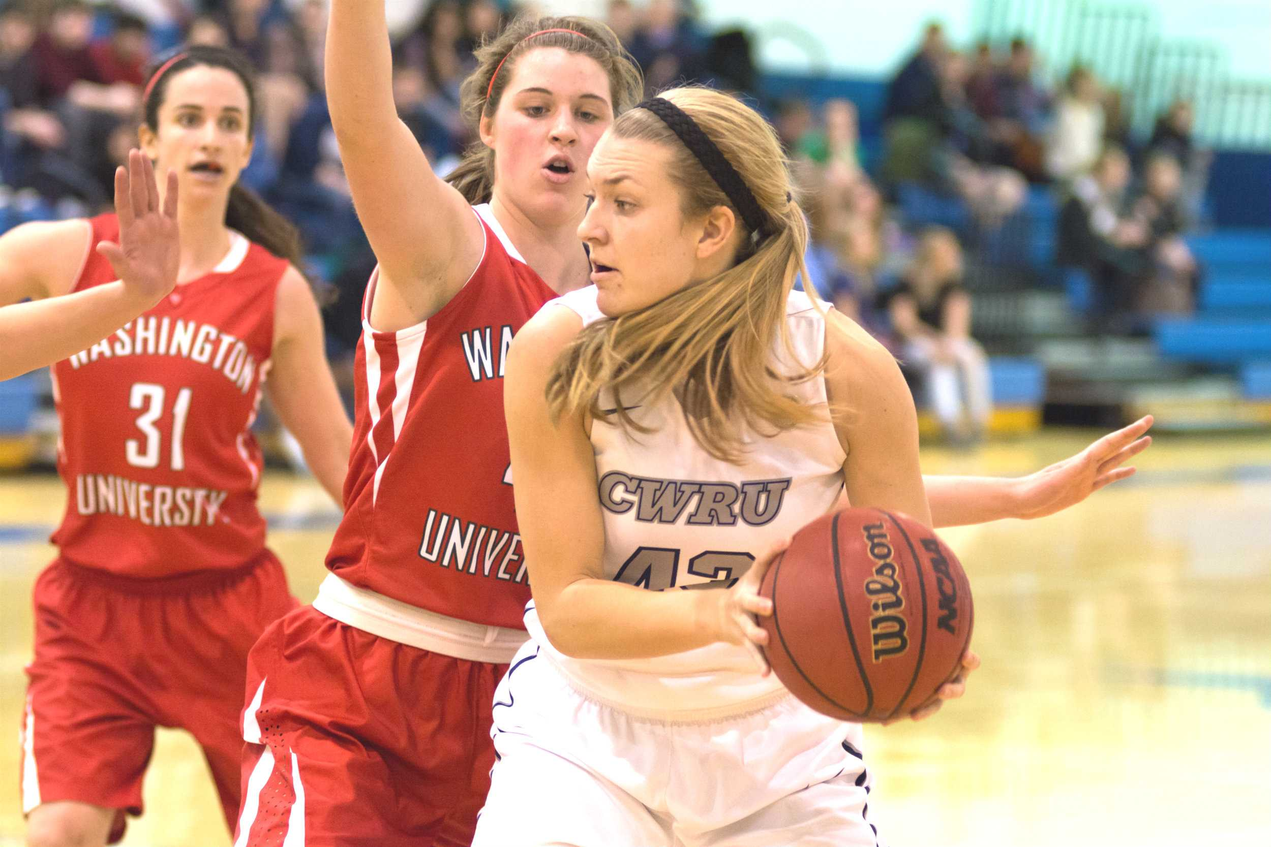 Spartans Laura Mummey looks for a teammate while under pressure earlier this season. Mummey helped boost the Spartans to their first UAA win this past weekend.