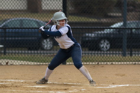 Softball slips twice then sweeps two
