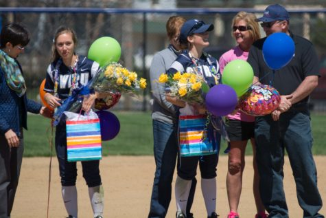 Softball splits six before senior sendoff
