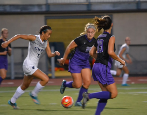 First-year forward Kimberly Chen (center) sprints past two Kenyon defenders.