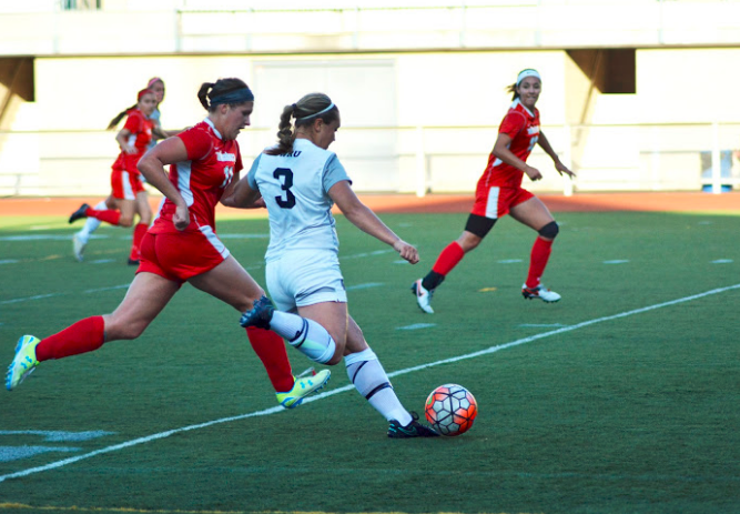 Fourth-year Amy Lindberg strikes the ball with fury during a recent match.