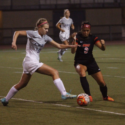 Second-year forward Maggie Tyma attempts to race past a Ohio Wesleyan defender and keep possession for the Spartans