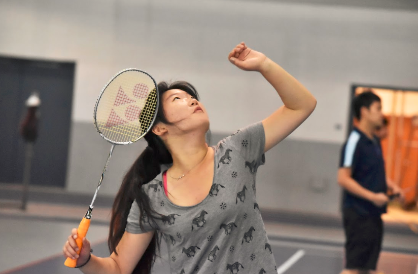 Keeping her eye on the shuttlecock, a member of the Badminton Club concentrates hard during a practice. The Club won all 11 matches in their first ever meet as an official club.