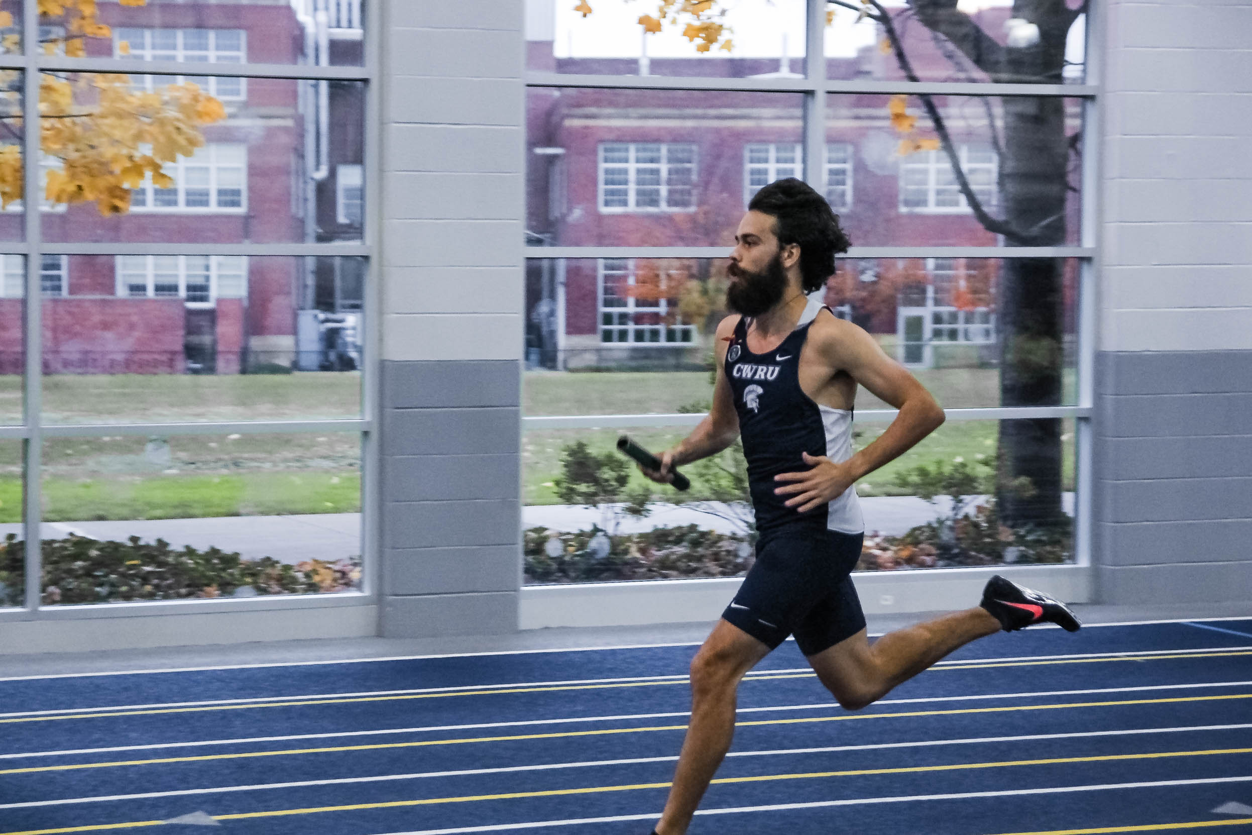 Nico Ericksen-Deriso sprints to connect with a teammate during a relay earlier in the season. The Spartans take on Carnegie Mellon University in the Ninth Annual Battle for the Obelisk.