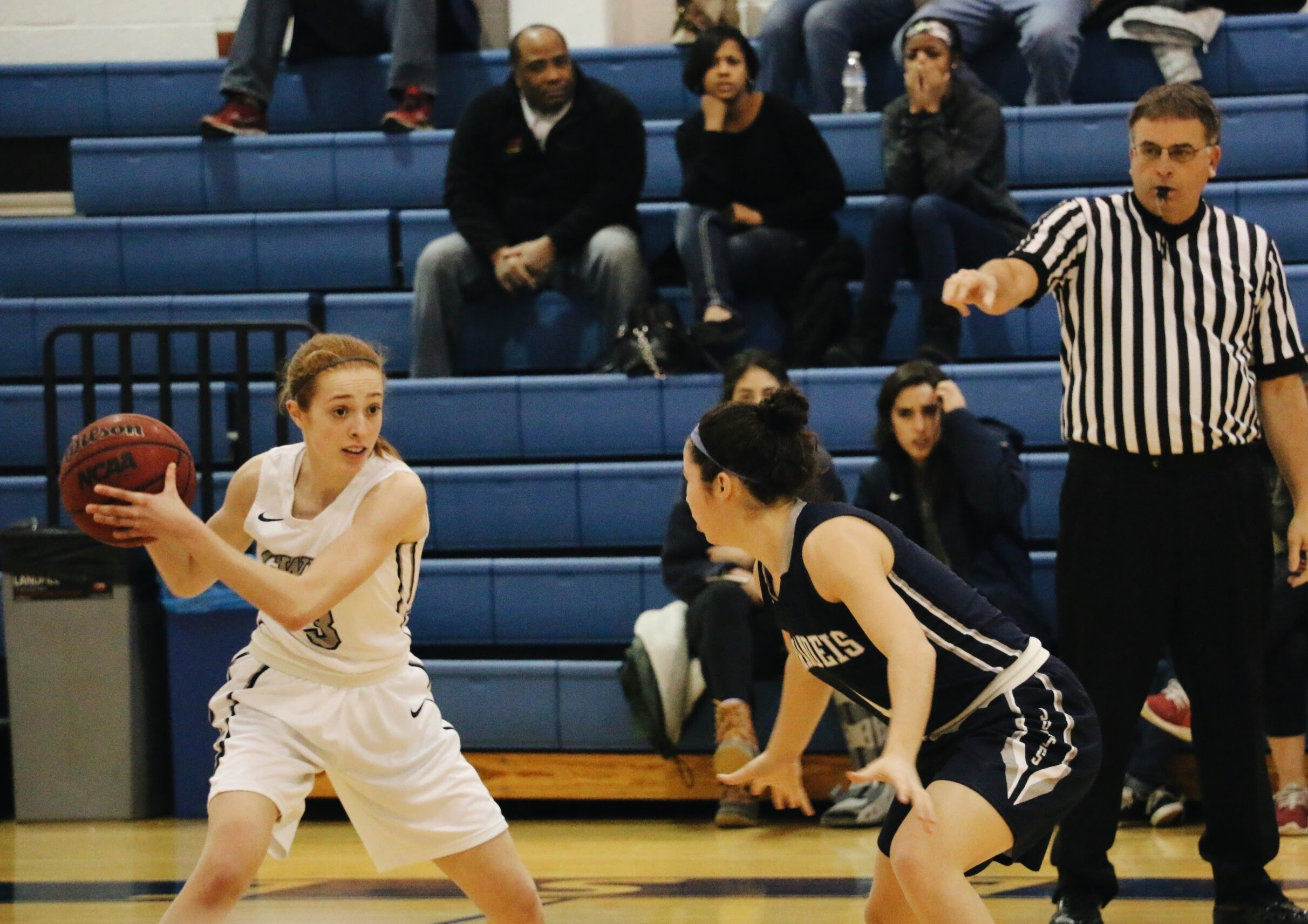 First-year guard Marissa Muth searches for a teammate past a Brandeis defender.