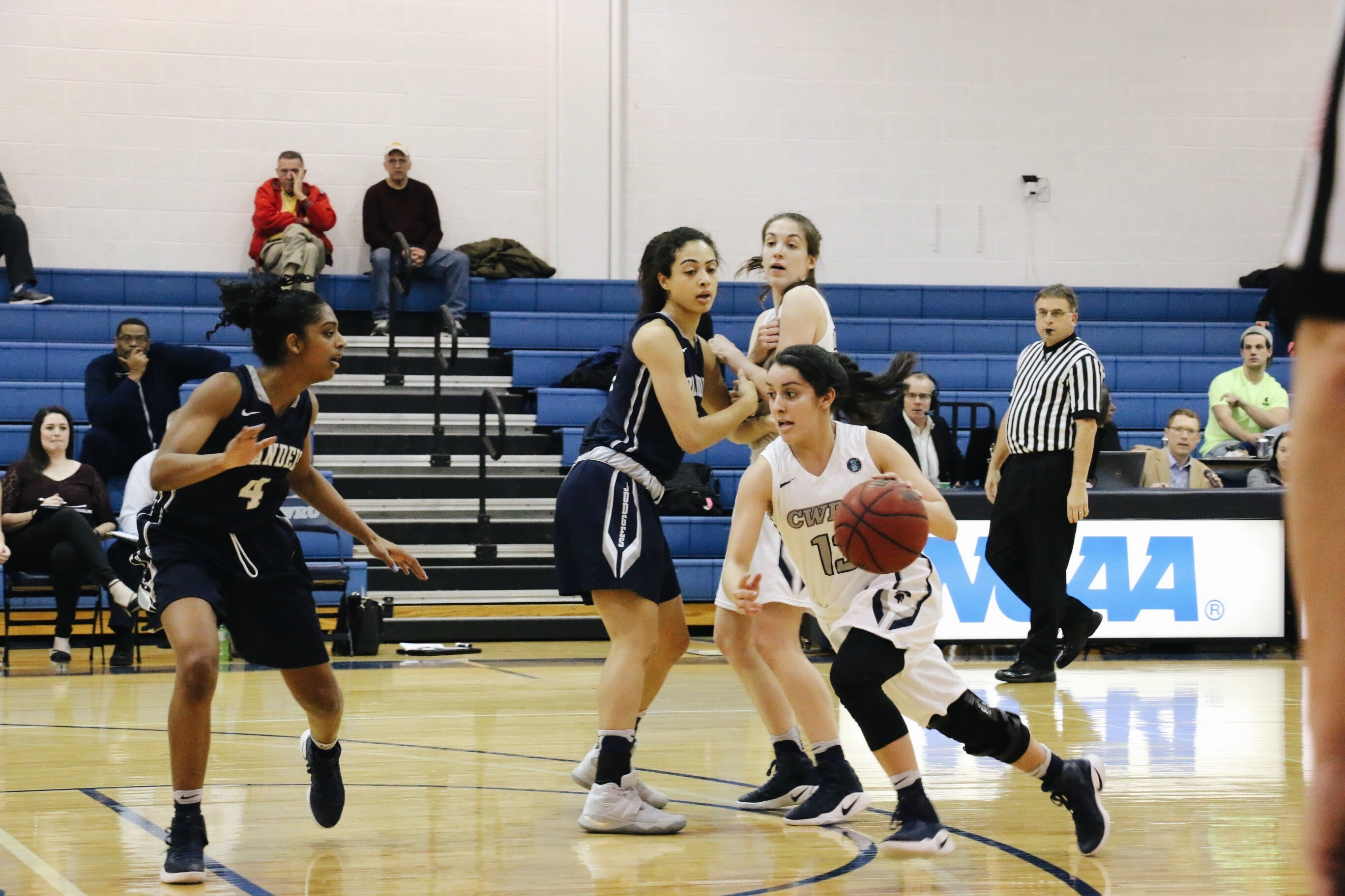 Alicia Marie Gonzales drives off of a pick from a helpful teammate on her way to the basket.