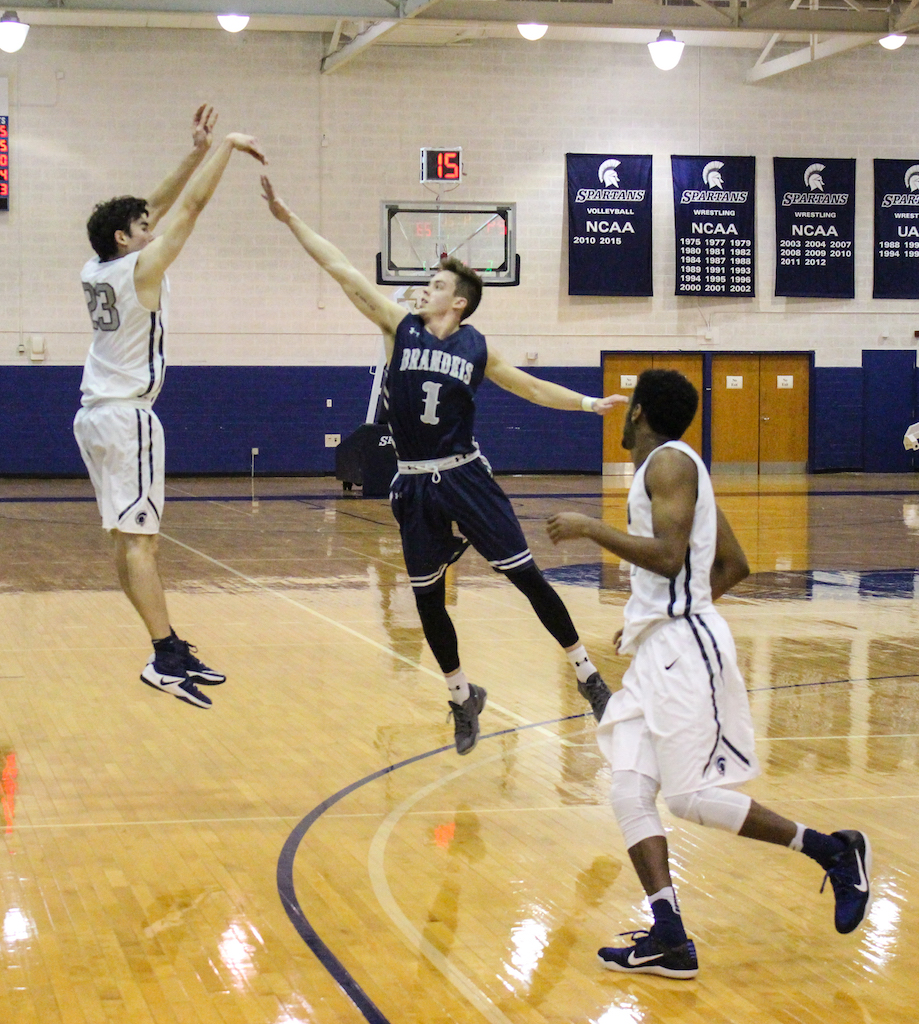 Sam Henson drains a three-pointer against Brandeis. The first-year forward was a perfect six-of-six from beyond the arc.