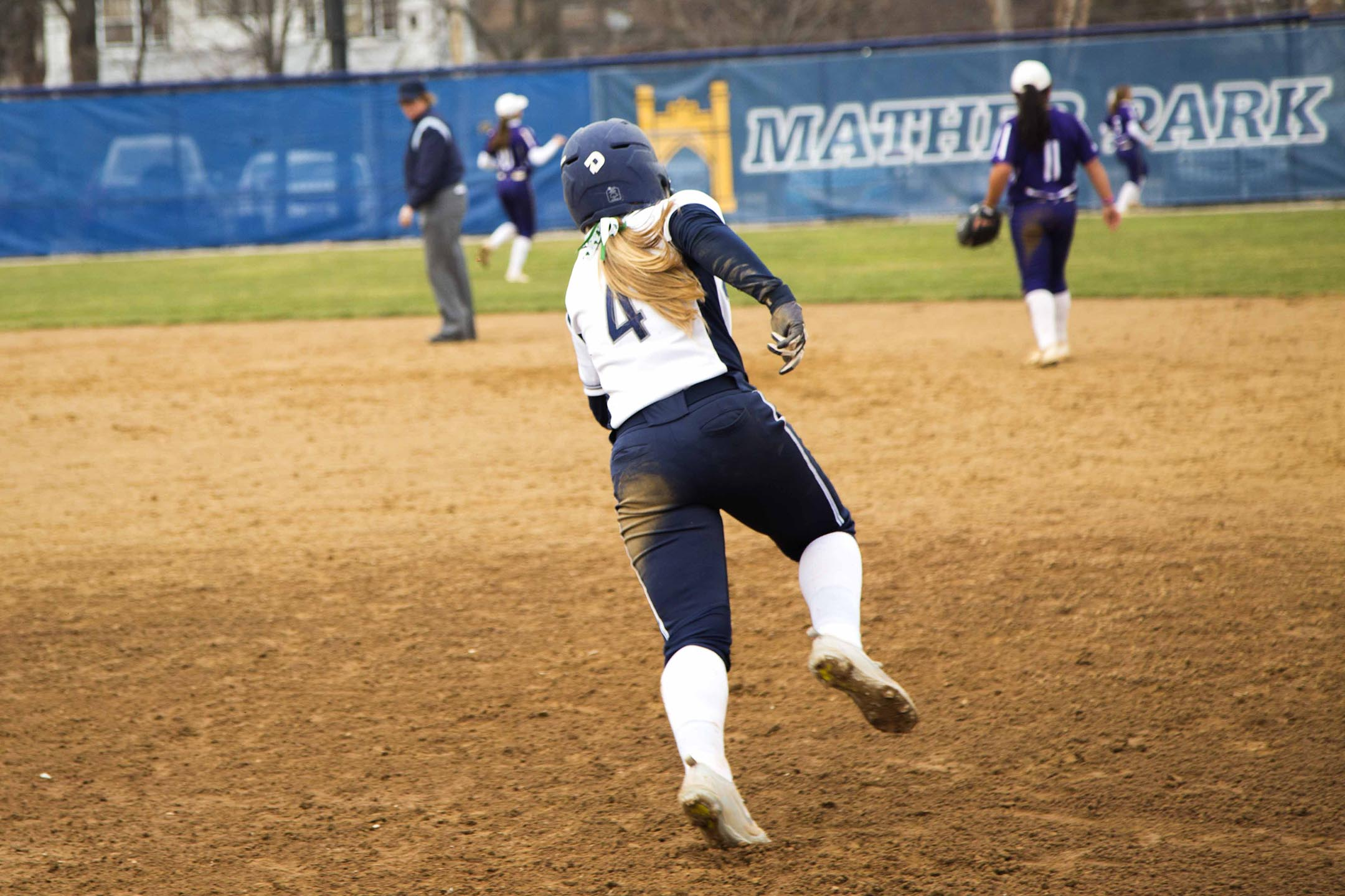 Infielder Nicole Doyle rounds first after hitting a deep double against Kenyon.