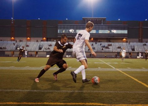 Men's soccer splits first two games