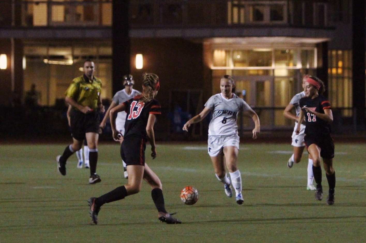 Midfielder and forward Melanie Kukura dribbles by a pair of defenders during a game last year.
