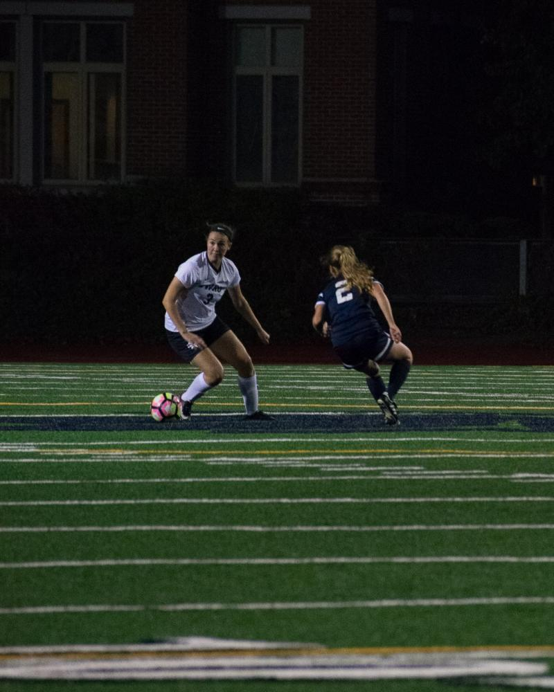 First-year midfielder Lauren LaPointe tries to dribble around a defender.