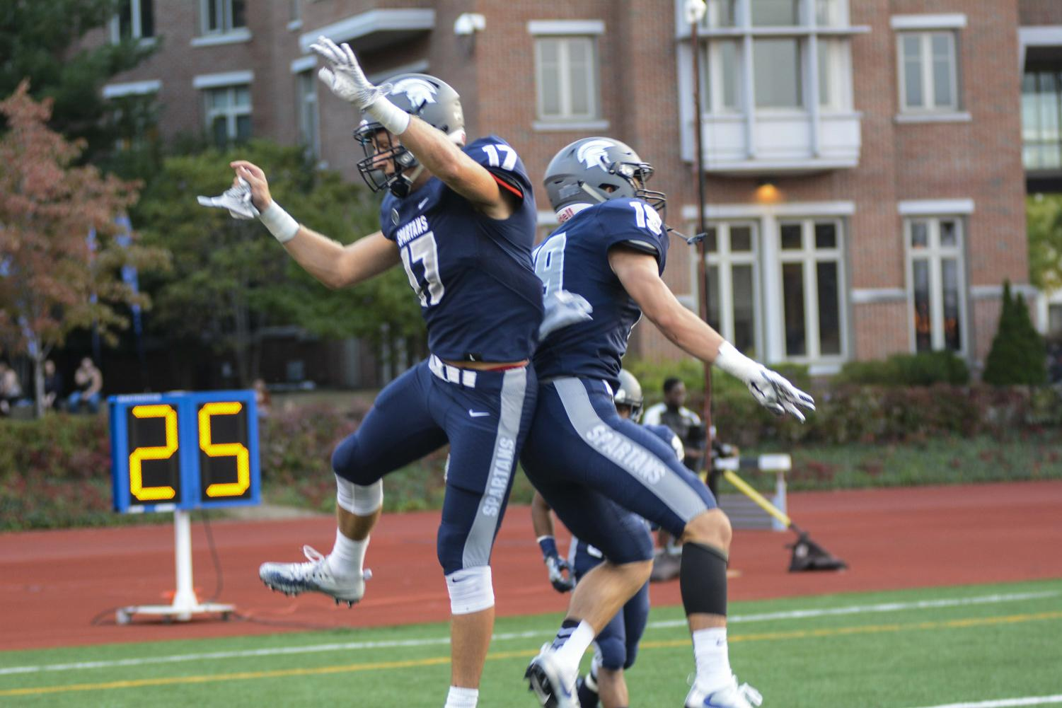 Wide receivers Giuseppe Orsini and Joey Spitalli celebrate following a touchdown earlier in the season.