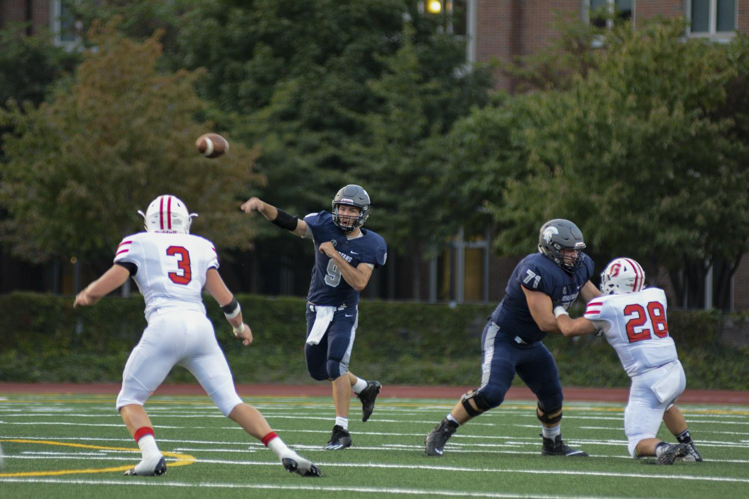 Fourth-year quarterback Rob Cuda threw for four touchdowns and ran for another in the Spartans' win over Saint Vincent College.