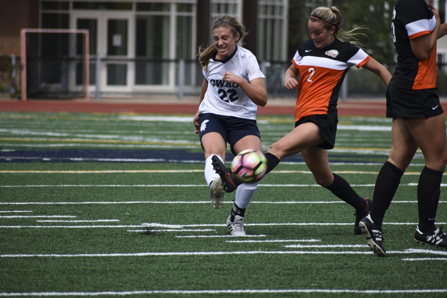 Kicking the ball past a defender earlier in the season, fourth-year midfielder Elle Zadina braces for impact. The Spartans lost their first conference match, but rebounded with a win on Oct. 3.