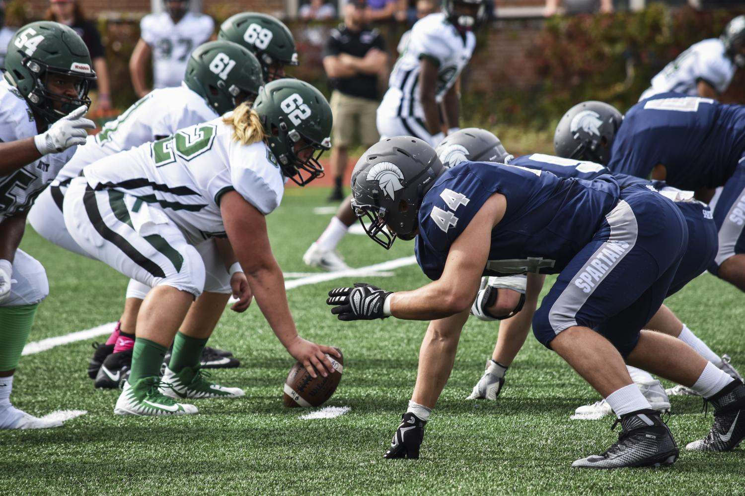 CWRU defensive linemen await the snap from Bethany