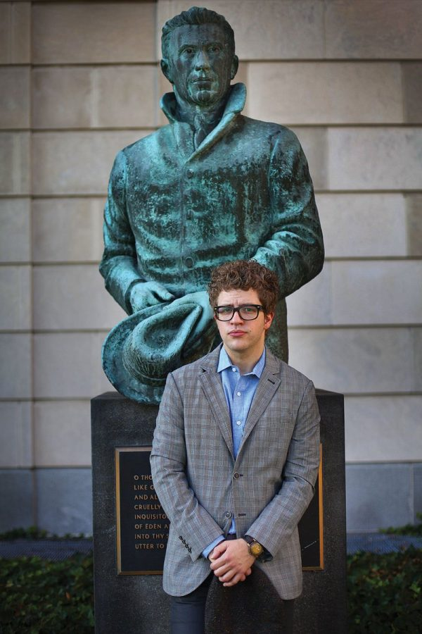 Dave+Lucas+standing+with+a+statue+of+Cleveland+poet+Hart+Crane+behind+the+Kelvin+Smith+Library.+The+Poet+Laureate+cites+this+as+one+of+his+favorite+spots+on+campus.