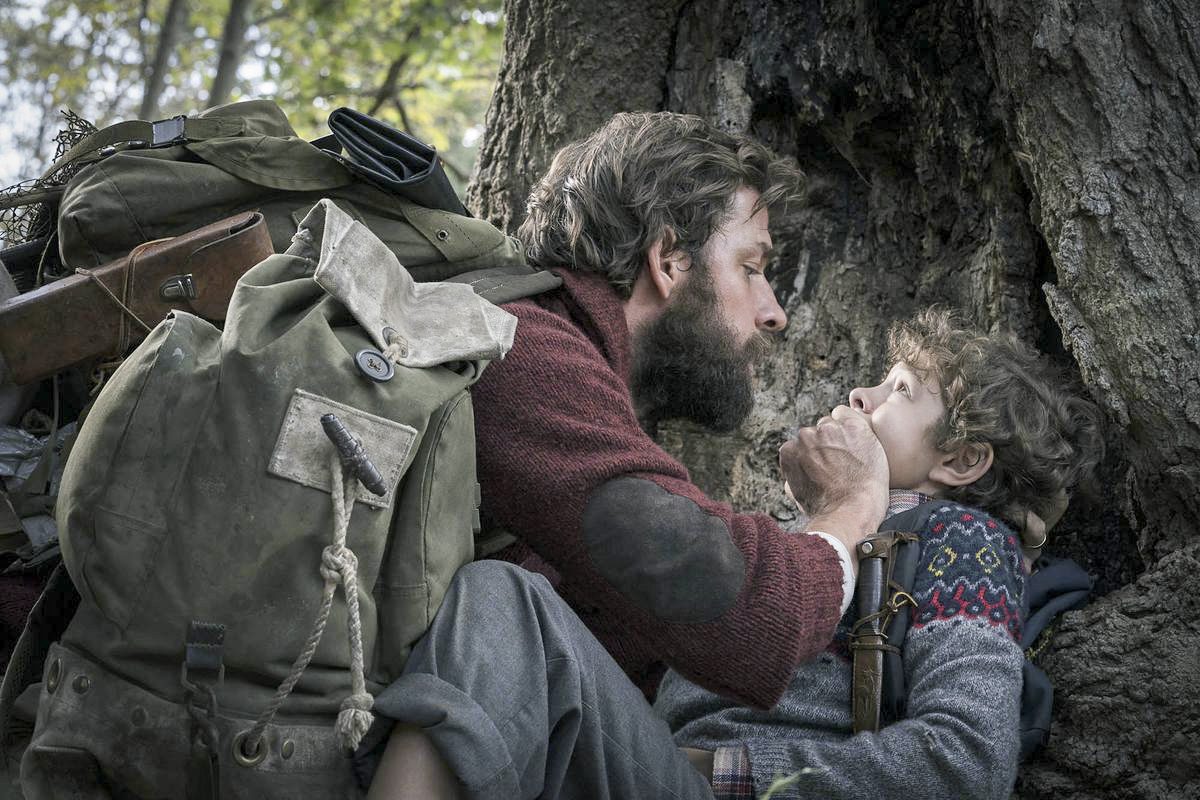 Director and actor John Krasinski silences co-star Cade Woodword in
