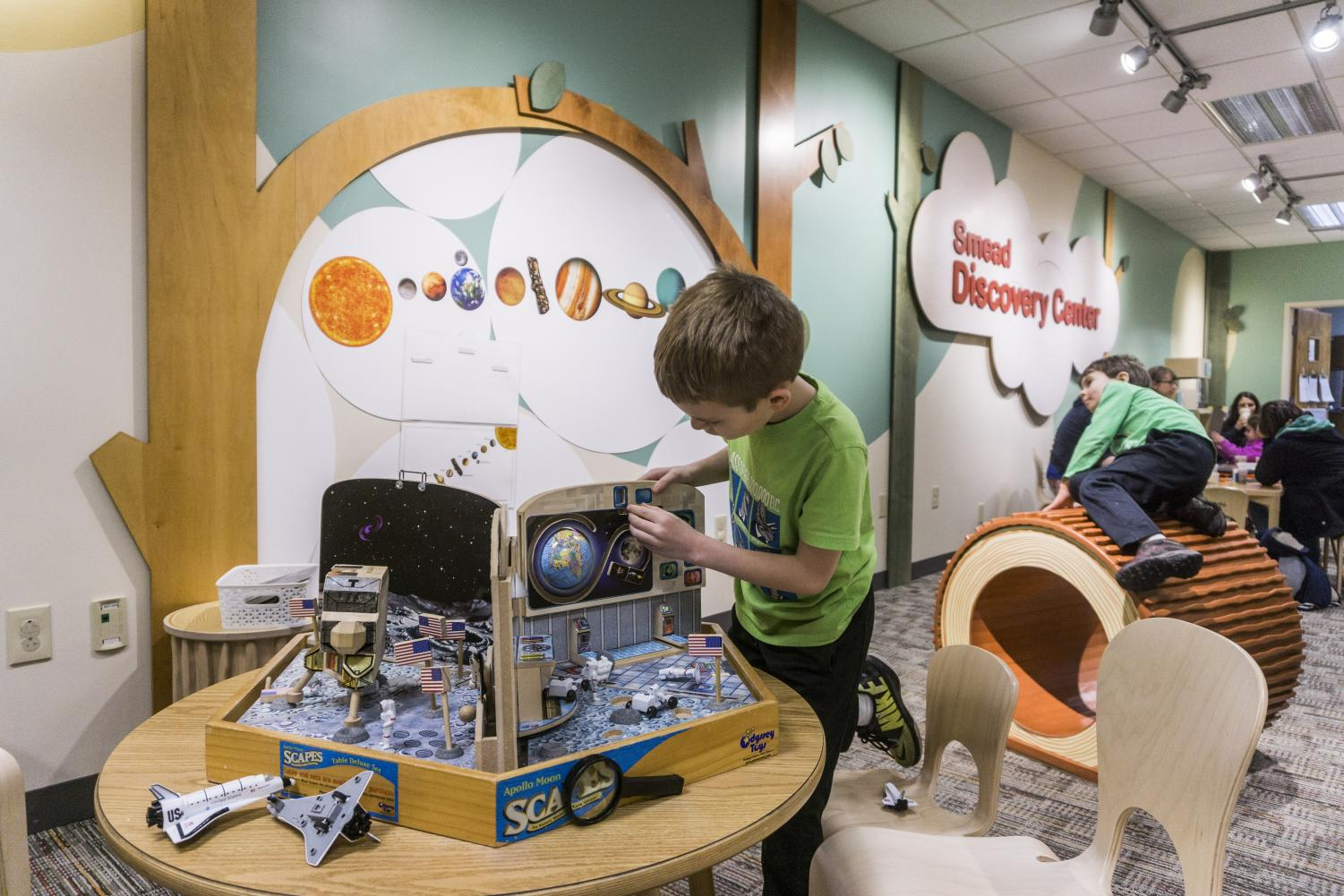 Parents and children engage in creative and educational activities centered around astronomy for the Cleveland Museum of Natural History (CMNH)'s Astronomy Day.