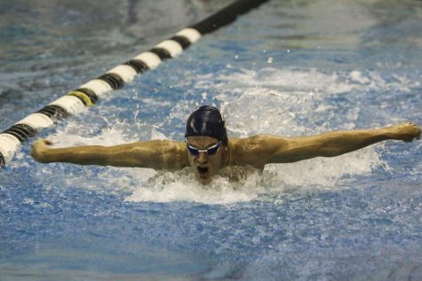Second-year swimmer fights the pain to succeed