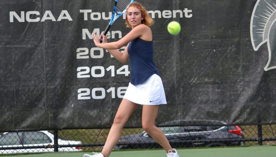 First-year+Spartan+Eliza+Georgiades+keeps+her+eye+on+the+ball+while+competing+in+a+tennis+match.+The+women%E2%80%99s+tennis+team+traveled+to+Florida+for+their+spring+break+trip+where+they+played+five+matches%2C+claiming+wins+in+three+of+them.