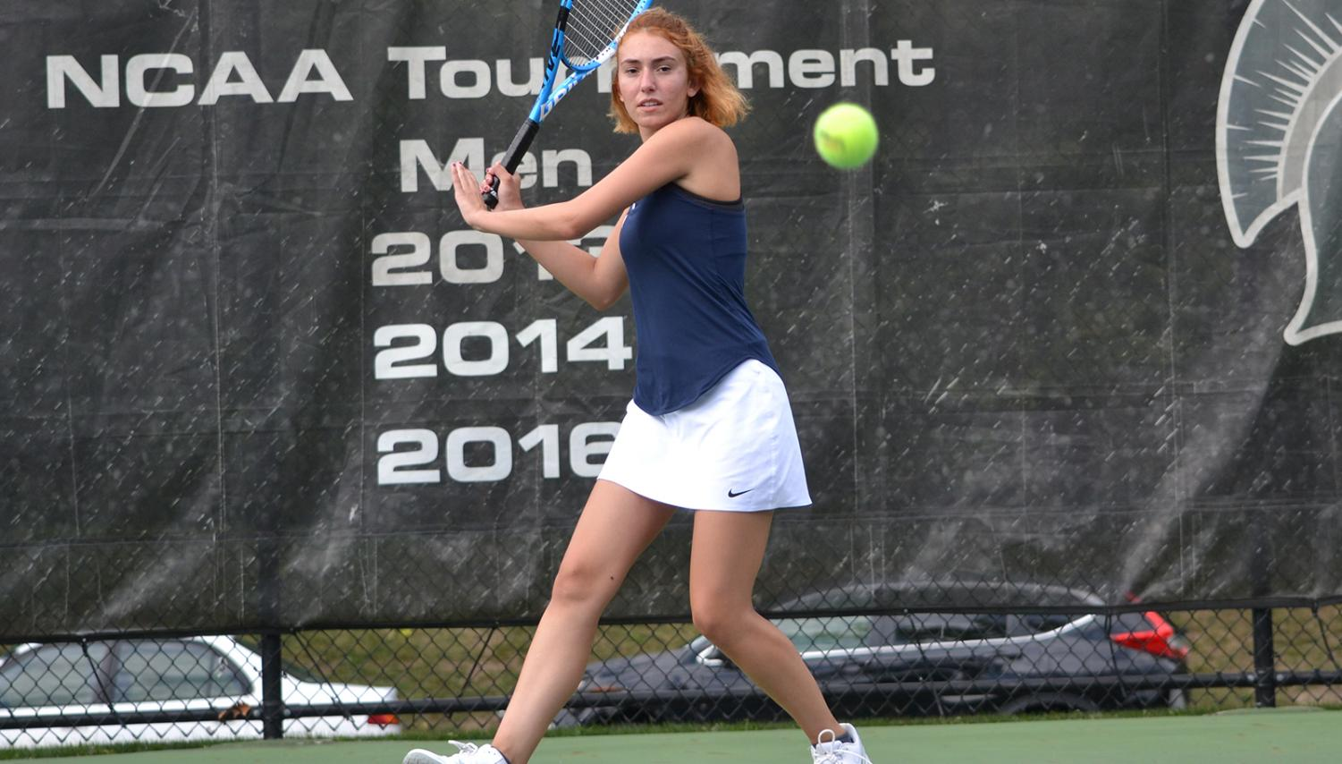 First-year Spartan Eliza Georgiades keeps her eye on the ball while competing in a tennis match. The women's tennis team traveled to Florida for their spring break trip where they played five matches, claiming wins in three of them.