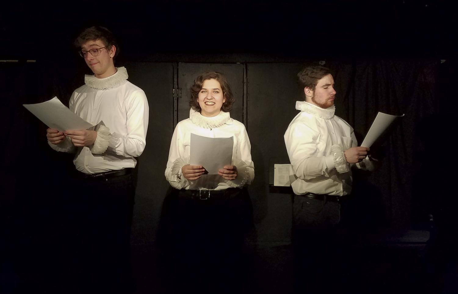 From left to right, second-year students Nathan Waniorek and Ashlen Trapalis and fourth-year student Alex Gordon recite lines from Shakespeare's comedies. Upper: During a scene in the production, a ghost visits two characters, portrayed by second-year student Ashlen Trapalis and fourth-year student Alex Gordon.