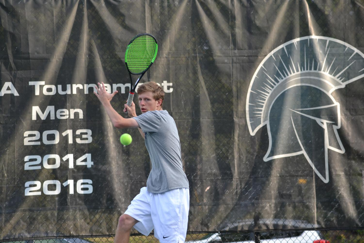 Sam Concannon maintains focus during a match. The men's tennis team won all four of their matches last week.