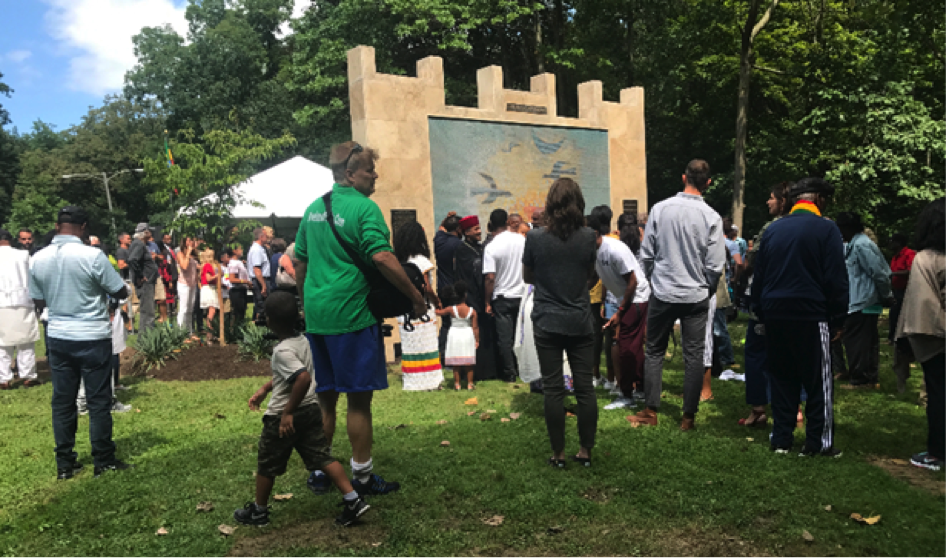 A five-panel mosaic and ceramic mural depicting Ethiopian history was reveled along with the Cultural Garden.