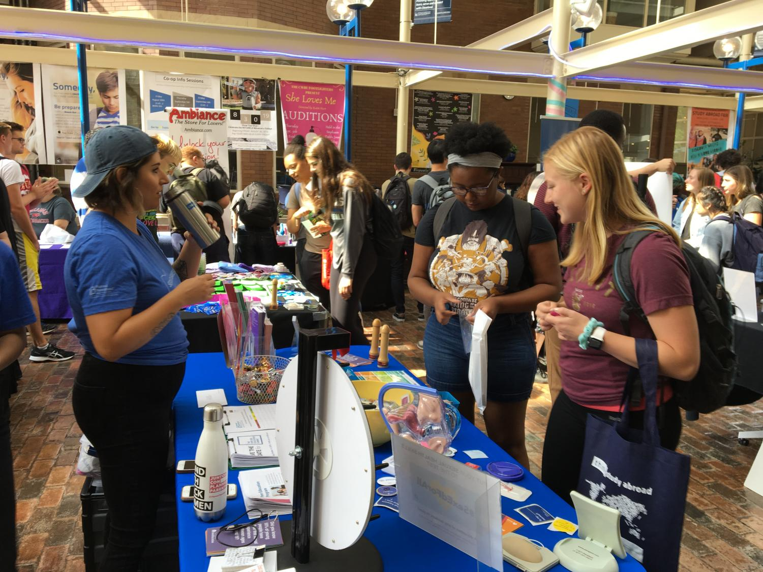 Students learn about safe sex practices at SEXPOpalooza 2019.
