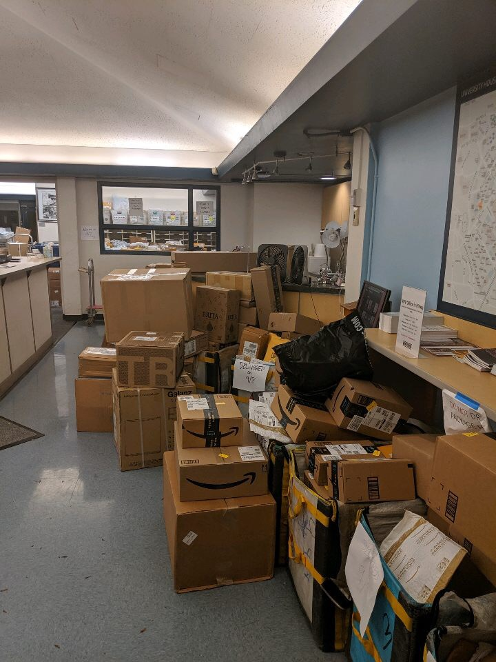 The area office in Wade Commons is overfilled with packages, causing problems for many students.