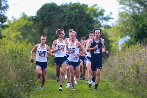 Men's tennis earns two wins, cross country honored