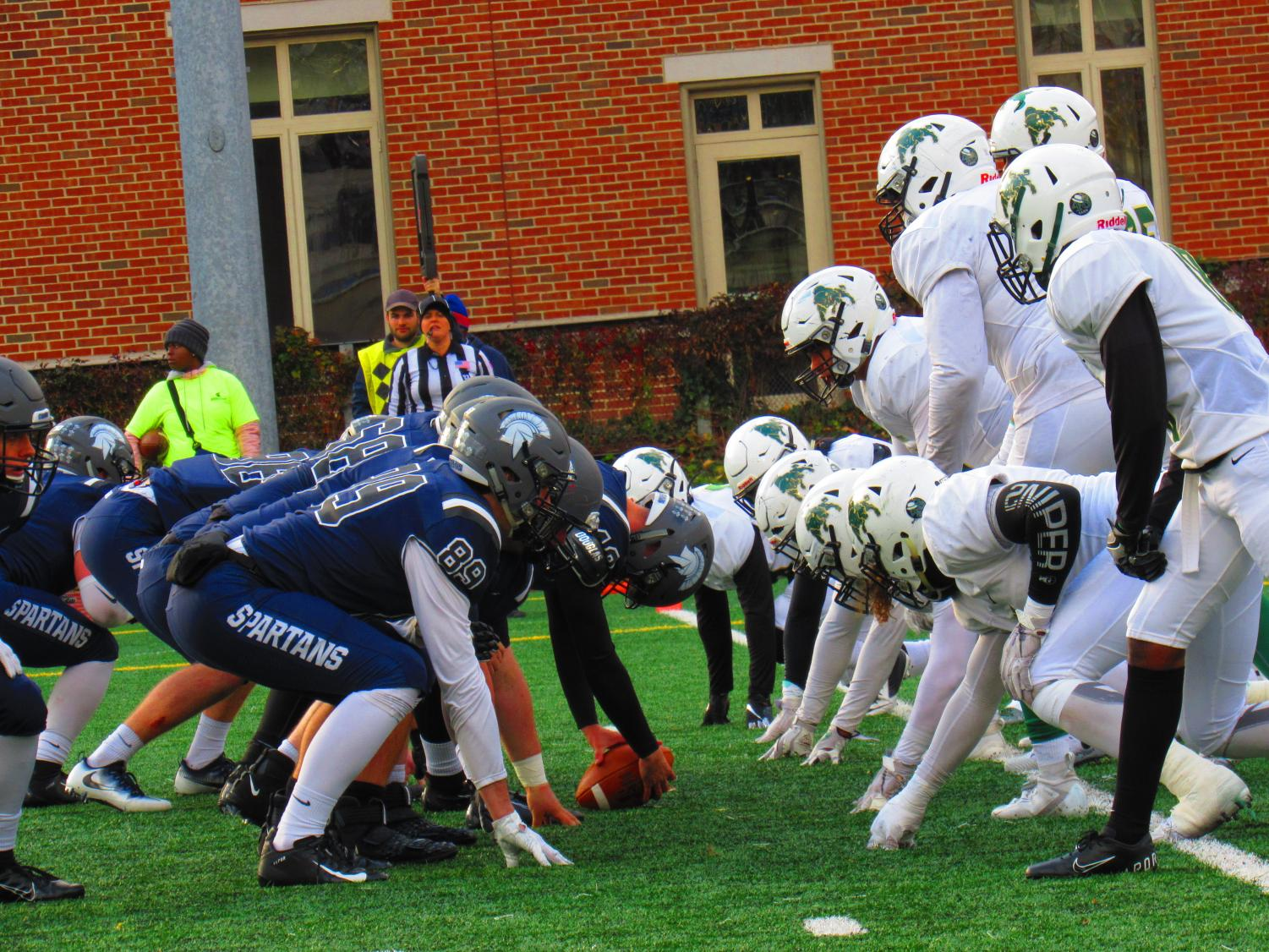 The Spartans football take their positions