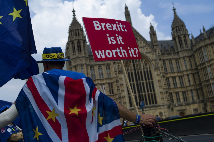 LONDON, ENGLAND: A man protests against Brexit outside the Houses of Parliament on July 5, 2018 in London, England. A prolonged heatwave continues to grip much of the country, with no rain falling in some part for over six weeks. While many enjoy the sunshine, the lack of water is having a dramatic affect. Farmers are finding it difficult to feed their cattle, water levels in reservoirs are falling rapidly and wildlife is struggling. As rivers dry up reports of 'mass fish die offs' have been reported. (Photo by Dan Kitwood/Getty Images)